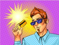 Vector pop art man with credit card. Vector pop art man in sunglasses holding credit card. Comic book vintage illustration Stock Illustration