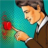 Vector pop art man pressing big red button. Vector illustration of handsome man pressing big red button in retro pop art comic style Royalty Free Stock Photos