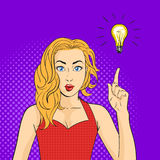 Vector pop art surprised woman face. Hand with finger pointing up. Light bulb over the hand. Concept of creating new ideas or thoughts Stock Image