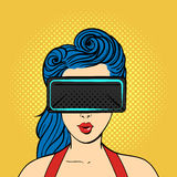 Vector pop art surprised woman wearing virtual reality glasses. Stock Photo