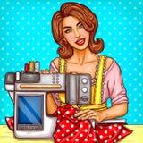 Vector pop art woman seamstress sews on machine Royalty Free Stock Photography