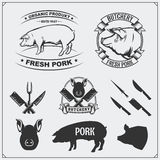 Vector pork meat labels and design elements. Butcher`s business logos. Silhouettes of pig and cutlery. Stock Images