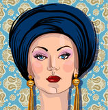 Vector portrait of woman in oriental headdress Stock Image