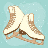 Vector postcard design with ice skates Stock Photos