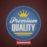 """Vector premium quality fabric badge. Detailed icon representing fabric badge with embroidered """"Premium quality Stock Photography"""