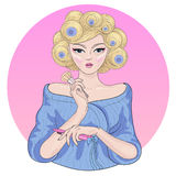 Vector pretty girl in curlers makes makeup Royalty Free Stock Image