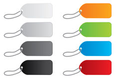 Vector Price Tags in 8 Colors. A set of 8  price tags done in full gradient coloring with beaded strings. Done in 4 shades of gray, as well as orange, green Stock Photos