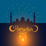 Vector Ramadan kareem lettering on mosque under blue star sky Stock Photos