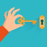 Vector real estate concept. Hand holding golden key in flat style Stock Photo