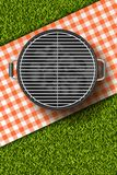 Vector realistic 3d illustration of barbecue grill, red plaid on green grass lawn. Bbq picnic in park. Royalty Free Stock Images