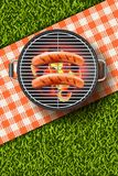 Vector realistic 3d illustration of grilled sausage on barbecue grill. Bbq menu, picnic in park, banner or poster design. Vector realistic 3d illustration of Stock Photos