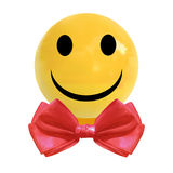 VECTOR realistic dragee candy with smiley face and red bow tie Stock Photos
