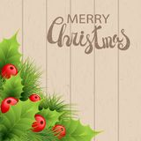 Vector realistic holly and fir tree branches. Christmas ornament. Holly green leaves and red berries on wooden background. Merry Christmas calligraphy text Royalty Free Stock Image