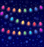 Vector realistic lantern garland on dark night sky background with snowflakes Stock Photo