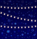 Vector realistic lantern garland on dark night sky background with snowflakes. Realistic lantern garland on dark night sky background with snowflakes Stock Photography