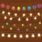 Vector realistic lantern garland on wood background with snowflakes Royalty Free Stock Photos