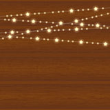 Vector realistic lantern garland on wood background with snowflakes. Realistic lantern garland on wood background with snowflakes royalty free illustration