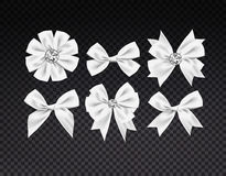 Vector realistic ribbon shaped white bows set. dark transparent background Royalty Free Stock Photo
