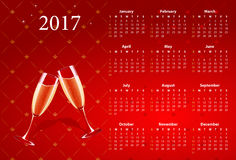 Vector red calendar 2017 with champagne glasses Stock Image