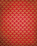 Vector red grunge background with heart pattern. Royalty Free Stock Photo
