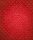 Vector red grunge background with heart pattern. Stock Image