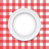 Vector red tablecloth and empty plate. Vector red picnic tablecloth and empty plate Royalty Free Stock Image