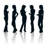 Jonge vrouwensilhouetten Royalty-vrije Stock Foto's
