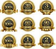Vector reeks van 100% waarborg gouden etiketten stock illustratie