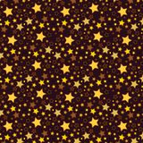 Golden yellow and brown stars in a seamless pattern
