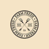 Vector retro family farm logotype. Organic premium quality products badge. Vintage hand sketched pitchforks icon. Vector retro family farm logotype. Organic Royalty Free Stock Image