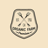 Vector retro family farm logotype. Organic premium quality products badge. Vintage hand sketched pitchforks icon. Vector retro family farm logotype. Organic Royalty Free Stock Photo