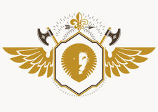 Vector retro insignia design decorated with eagle wings and made Royalty Free Stock Images