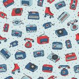 Vector retro seamless pattern with antique tech, radio, typewrit. Er, roller skates and vinyl record player Stock Photo
