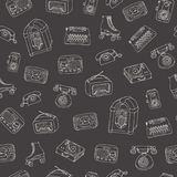 Vector retro seamless pattern with old tech, juke box, radio, typewriter. Roller skates and vinyl record player outline on the blacboard background. Hand drawn vector illustration