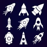 Vector rockets icons set on space background Royalty Free Stock Photos