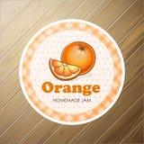 Vector rond etiket, oranje jam op een houten achtergrond Stock Afbeelding