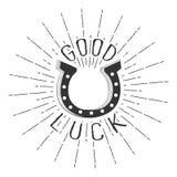 Vector a rotulação monocromática do texto da boa sorte com a ferradura e os raios da explosão isolados no fundo branco Imagens de Stock