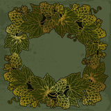 Vector round frame with ornate Hops or Humulus in gold on the vintage dark background. Stock Photo