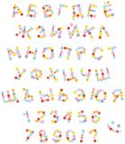 Funny floral font for holidays. Vector Russian alphabet and numerals with flowers drawn in funny cartoon style Stock Images