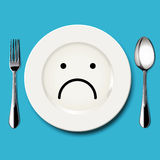 Vector of sad face draw on white plate Stock Photos
