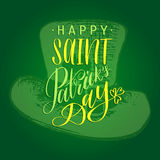 Vector Saint Patrick`s Day hand lettering greetings card or poster design. Sketched leprechaun hat on green background. Vector Saint Patrick`s Day hand Royalty Free Stock Images