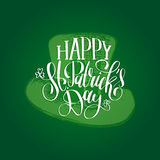 Vector Saint Patrick`s Day hand lettering greetings card or poster design. Sketched leprechaun hat on green background. Stock Photos
