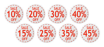 Vector sale signs. Set of vector red sale signs on piece of textile Royalty Free Stock Images