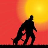 Vector Schattenbild eines Mannes mit einem Hund Stockfotos