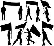 Vector Schattenbilder Mann und Frauen mit Markierungsfahne und Transparent Lizenzfreie Stockfotografie