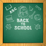 Vector school chalkboard background with hand drawn childish style illustrations. Stock Image
