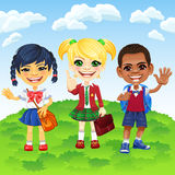 Vector schoolchildren of different nationalities Stock Images