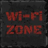 Vector scratched inscription Wi-fi red zone on an old shabby sha. Bby gray wall Stock Images