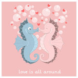 Vector seahorses with hearts Stock Images