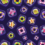 Vector seamless background with colorful Halloween. Candies Stock Images